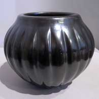 Angela Baca of Santa Clara Pueblo made this carved black melon jar