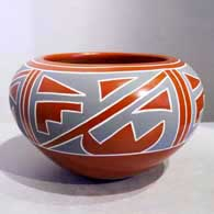Four-panel geometric design on a polychrome red bowl