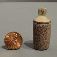 Geometric design on a miniature lidded jar