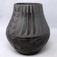 Black on black jar with jeather and geometric design, by Carmelita Dunlap of San Ildefonso Pueblo