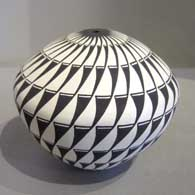 Geometric design on a black and white seed pot