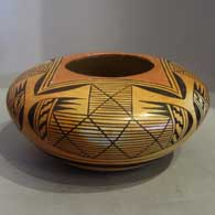 Awatovi star and batwing design on a yellow ware jar
