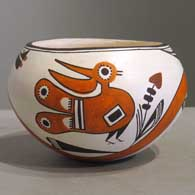 Bird, flower, rainbow and geometric design on a polychrome jar
