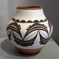 Black and white geometric design on a polychrome water jar