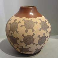 Sgraffito turtle design on a brown jar