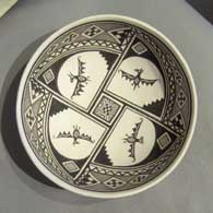 Mimbres bat and geometric design on a black and white plate