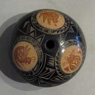 Sienna spots and sgraffito designs on a black seedpot