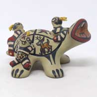 Polychrome turtle storyteller with animal, geometric design and 3 turtle children