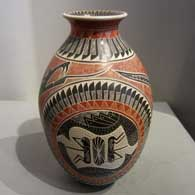 Sgraffito and painted grasshopper, serpent, feather and geometric design on a polychrome jar