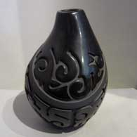 Geometric design carved into a black on black jar, by Nathan Youngblood