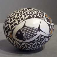 Mimbres and geometric design on a polychrome seedpot