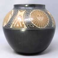 Black jar with sienna spots and sgraffito wildlife and geometric designs