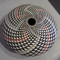Geometric design on a polychrome seedpot