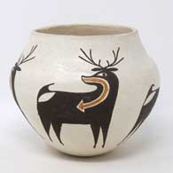 The Zuni deer and heart line decorate this polychrome jar by Rose Chino Garcia
