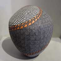 Swirl, fine line and geometric design on a polychrome jar