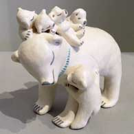 Five cubs on a bear storyteller figure, made by Isleta Pueblo potter Stella Teller