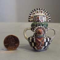 Miniature pot with 3 lids, 4 faces and double handles