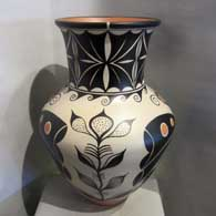 Traditional Santo Domingo geometric design on a tall neck polychrome jar