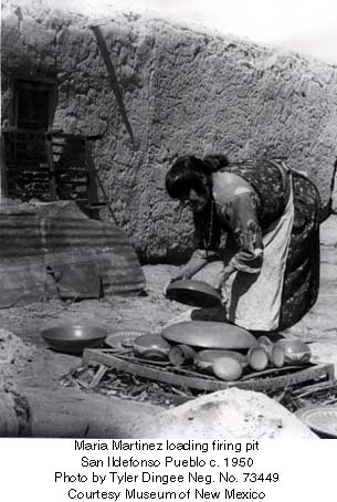 Maria Martinez loading firing pit San Ildefonso Pueblo c. 1950 Photo by Tyler Dingee Neg. No. 73449 Courtesy Museum of New Mexico