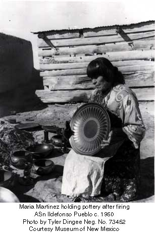 Maria Martinez holding pottery after firing San Ildefonso Pueblo c. 1950 Photo by Tyler Dingee Neg. No. 73452 Courtesy Museum of New Mexico