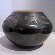 Black jar with sienna rim and sgraffito avanyu with an inlaid stone  , click or tap to see a larger version
