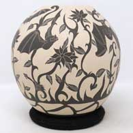 Black and white jar with sgraffito bat, vine and flower design, click or tap to see a larger version