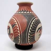 Polychrome jar with sgraffito and slipped medallion, lizard and geometric design, click or tap to see a larger version