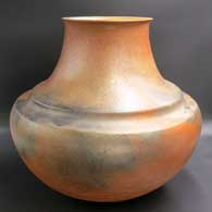 Large double-shoulder golden micaceous jar with fire clouds, click or tap to see a larger version