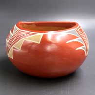 Polychrome bowl with a triangular opening and geometric design, click or tap to see a larger version