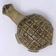 Polychrome turtle figure with insect, reptile and animal designs, click or tap to see a larger version
