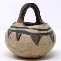 Polychrome basket with handle and geometric design, click or tap to see a larger version