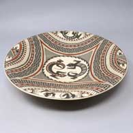 Shallow polychrome bowl with lizard and geometric design inside, click or tap to see a larger version