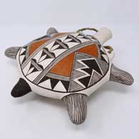 Polychrome turtle canteen with fine line and geometric design, click or tap to see a larger version