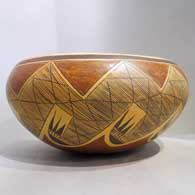 Polychrome bowl with migration pattern design and fire clouds, click or tap to see a larger version