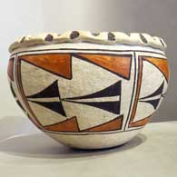 Polychrome jar with geometric design, click or tap to see a larger version