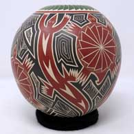Polychrome jar with sgraffito and painted lizard, turtle and geometric design , click or tap to see a larger version