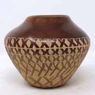 Brown jar with sgraffito geometric design, click or tap to see a larger version