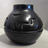 Black jar carved with geometric design, click or tap to see a larger version