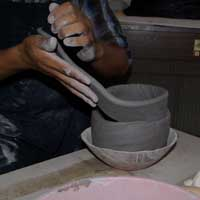 Adding the second coil of clay