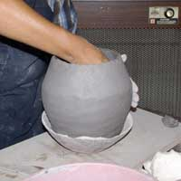Stretching and shaping the pot from inside