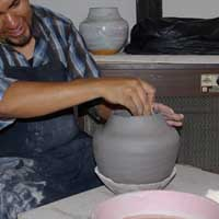 Stretching and shaping the pot